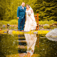 pond reflection wedding pose
